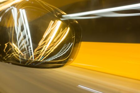 gold en: Motoring abstract Rear vision mirror travelling through tnnel picks up lights of other cars  in golden hues Victoria Tunnel Wellington Stock Photo