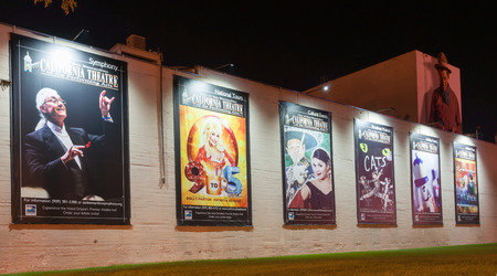 show bill: San Bernardino, California, USA - October 3, 2015: Musical show posters on exterior wall of California Theatre of the Performing Arts illuminated at the theater in San Bernardino, California, USA. Editorial