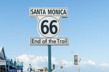 end of the trail: Santa Monica, USA - October 6, 2015: Route 66 Santa Monica  End of Trail sign on Santa Monica Pier with restaurants, shops and kiosks a popular tourist destination Los Angeles California,USA.