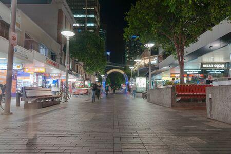urban scene: Brisbane, Australia - April 26, 2016: In city at night Brisbane street at night  Queen Street mall with shop front lights