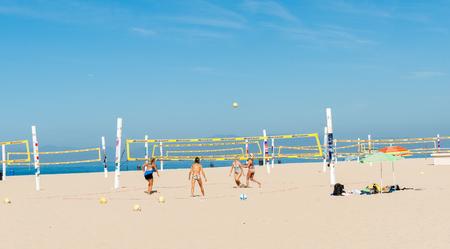 hermosa beach: Hermosa Beach, California, USA; October 8, 2015; Women taned and fit playing Beach volleyball under Californian summer sky on Hermosa Beach