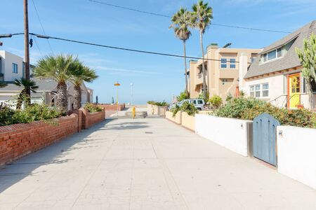 hermosa beach: Residential lane lined by fences, homes and gates in seaside town Hermosa Beach, California USA