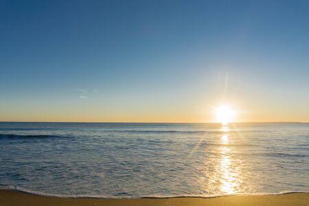golden glow: Papamoa Beach, outlook to horizon beautiful golden glow into sunrise Stock Photo