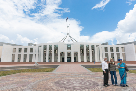 Canberra: Canberra, Australia - January 23, 2011; Three Asian tourists pose for photo outside Australian Parliament House in Canberra. Editorial