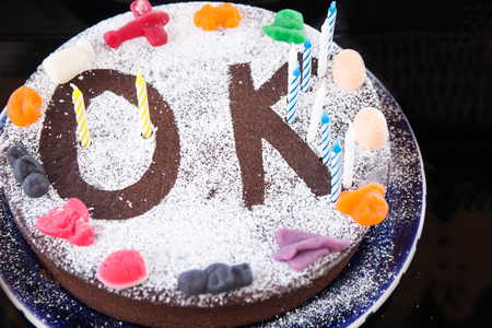 alright: Decorated cake symbolising everything is alright, OK Stock Photo