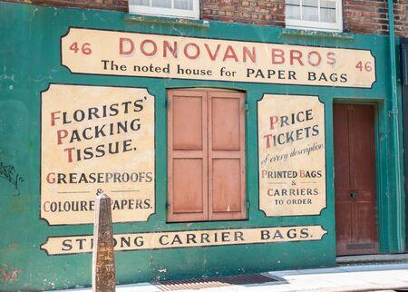 bros: London, England - August 2, 2103; Faded original style signwritten wall Donovan Bros business marketing their products at 46 Gun Street, Spitalfields, London