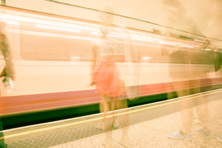 moving images: Abstract Transport background blurred images of waiting on platform commuters and train moving iin station typically modern urban life. Stock Photo