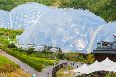 eden: Cornwall, England - July 24, 2013: Eden Project white geodesic biome domes surrounded by outdoor gardens is tourist attraction and plant research and environmental education complex on Cornwall England. Editorial