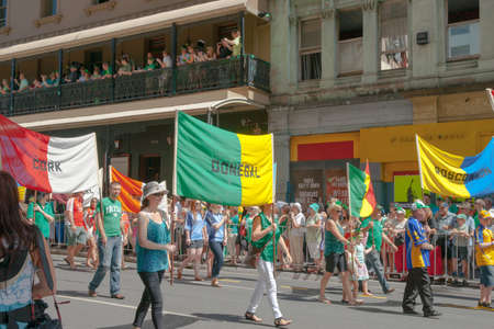 st  paddy's day: Brisbane, Australia - March 16, 2013; Crowds involved or watching parading Irish  in predominant color of green holding regional banners in Brisbane streets on St Paddys Day