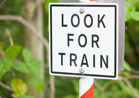 look for: Look for train warning sign black lettering on white background. Stock Photo
