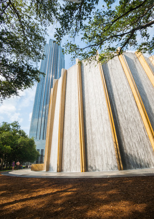 water feature: Houston Texas, USA - August 14, 2016: Water feature and stunning glass tower in Gerald D. Hines Waterwall Park with Williams Tower rising in background in Uptown or Galleria District Houston