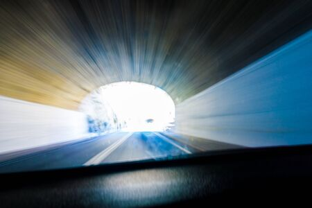 zooming: Abstract through car windscreeen light at end of tunnel