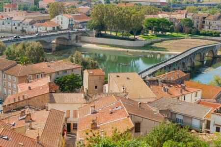 Urban roof tops and Orb River and bridges from top of Cathedral Saint Nazaire Beziers France