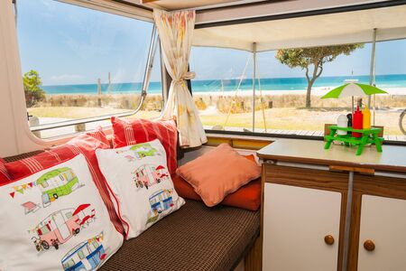 Summer holidaying in retro luxury caravan at beach, Mount Maunganui New Zealand
