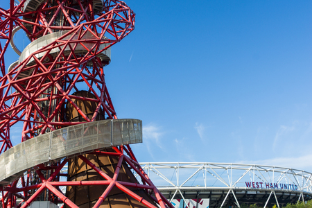 London England - October 17, 2016;  ArcelorMittal Orbit abstract red tubular spiralling steel structure on right  with silver outer walkway  at 114.5 metre Londons tallest sculpture a popular tourist attraction and observation tower in the Queen Elizabet Editorial