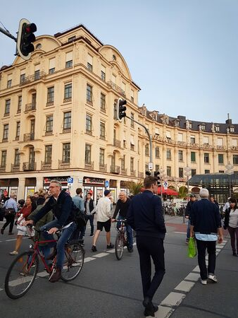 MUNICH, GERMANY- SEPTEMBER 8, 2017  mobile phone, Instagram effect of people crossing Karlsplatz to and from buildings and Karlsplatz Stachus at begining Neuhauser Strasse