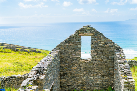 View through and around old stone house wall and window in one Wild Atlantic Way Stock Photo