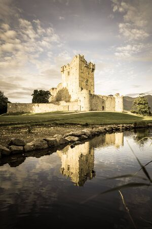 Irish castle ruins of Ross Castle on shore of Ross Lake, Killarney National Park, County Kerry Stock Photo