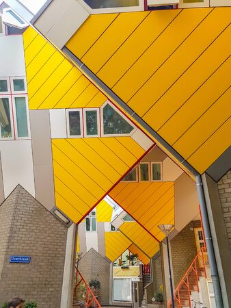 ROTTERDAM, HOLLAND - AUGUST 21, 2017; Cube houses are a set of bright yellow angled cube adjoining innovative architecturally styled apartments built in Rotterdam Editorial