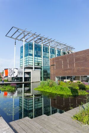 ROTTERDAM, HOLLAND- AUGUST 23, 2017; Het Nieuwe Instituut or New Institute for architecture arts and culture comprises archtiecturally differing modern low-rise buildings and lush gardens Editorial