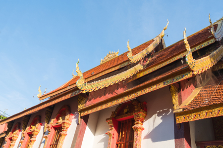 Traditional Asian style Buddhist temple gable ends and roof lines from low point of view Foto de archivo