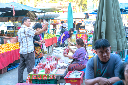 CHIANG MAI THAILAND - JANUARY 31 2018; Busy bustling local markets in small town in Chiang Mai Province with locals selling and buying their food needs.