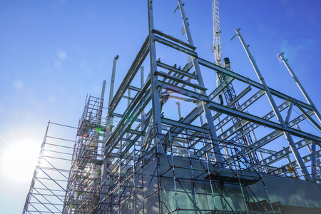 White structural steel framework for new building against deep blue sky. Imagens