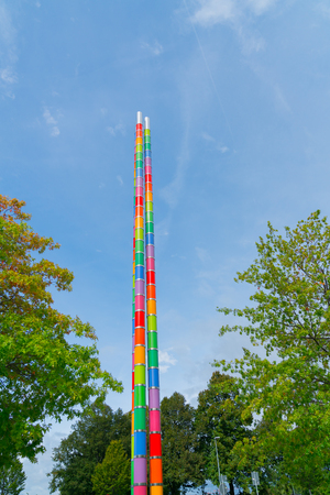 STUTTGART, GERMANY - SEPTEMBER 13 2017; Bright multi-colored totem pole artistic structure in grounds of Mercedes Museum of history of automobile manufacturer in the city.
