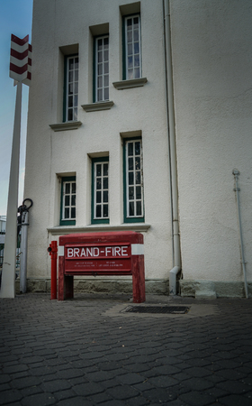 WINDHOEK NAMIBIA - MAY 11 2018; Old Railway Station and Museum displaying deco style design and red fire sign in German and English
