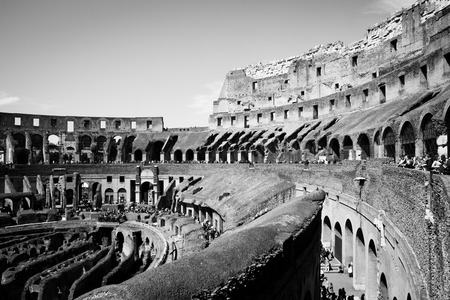 ROME ITALY APRIL 16 2011; Black and white image of tourists on many levels of and inside the colesseum