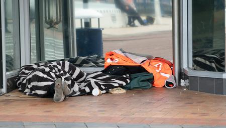 TAURANGA NEW ZEALAND - SEPTEMBER 22 2018;  Homeless people asleep under rugs in downtown doorway