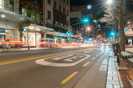 WELLINGTON NEW ZEALAND - OCTOBER 1, 2018; Night time in the city, street scene with long exposure creating lens flae and light trail effects Wellington, New Zealand. Editorial