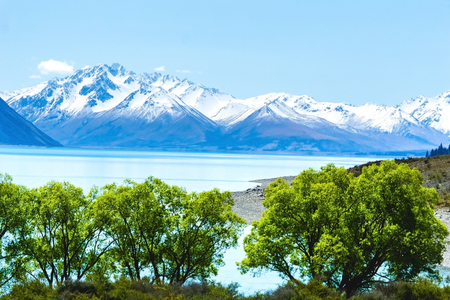 Lake Tekapo  mid image layer stunning scenery foreground layer and distant snow capped Southern Alps in rear focus layer