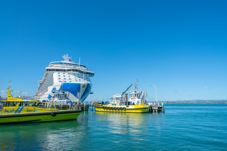 MOUNT MAUNGANUI NEW ZEALAND - FEBRUARY 10 2019:  Port of Tauranga two pilot boats and large cruise liner Majestic Princess berthed at Mount Maunganui wharf Editorial