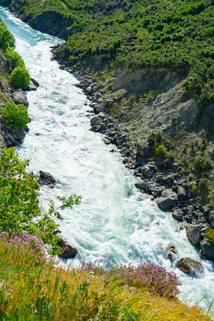 Kawarau River flowing through deep gorge in scenic Otago New Zealand 写真素材 - 119929967