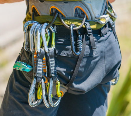 Mountaineering safety equipment hanging on harness close-up, ready to start. Reklamní fotografie