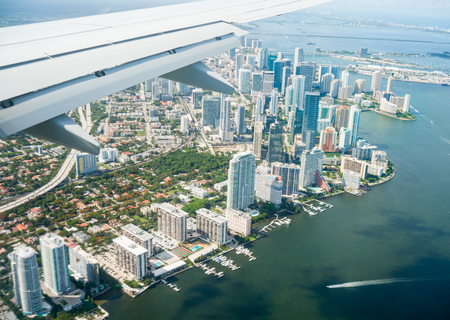 Aerial view of city of Miami flying in over city. 스톡 콘텐츠
