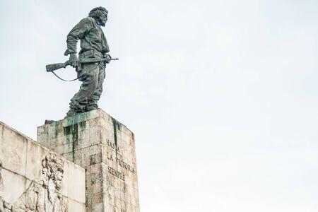 SANTA CLARA CUBA -July 1 2012; Revolutionary monument outside Santa Clara Cuba statue of Che Guevara holding rifle and engraved text of the revolution