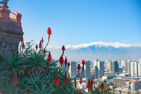 Modern urban skyline of Santiago Chile from high point of view of San Cristobal Hill  overlooking downtown commercial centre with snow-capped Andes mountains in background.