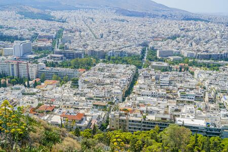 Urban Athens between foothills of mount Mount Lycabettus and distant hills from the highest point in the city, Greece.