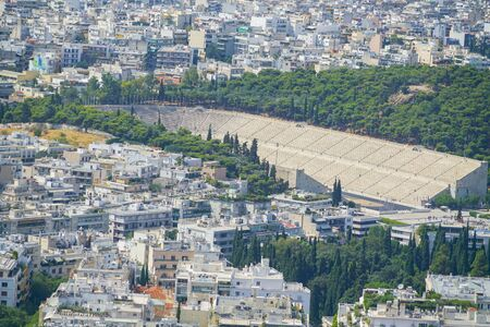Urban Athens view from top Mount Lycabettus the highest point in the city with Olympia Stadium in center, Greece. Banco de Imagens