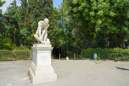 White Wood Breaker marble statue at one of entrances to National Gardens Athens, Greece.