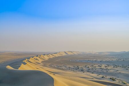 Desert at sunrise, Sealine Desert formations with low sun highlighting leading face of dunes and ripples