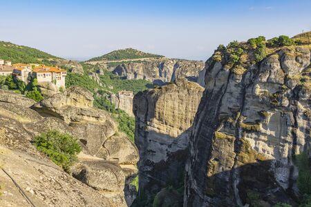 Geology and huge rocks and crevasses of Meteora with monasteries on top of giant rock pillars. Greece.
