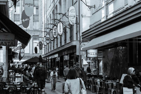 Melbourne Australia - March 10 2020; Grainy old-fashioned style image Degraves Street laneway with its, cafes, shops and characteristic signage as people walk through at start of day.