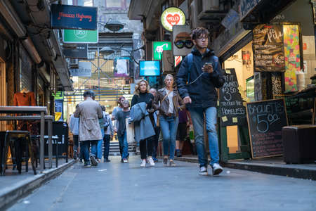 Melbourne Australia - March 14 2020; People in Degraves Street in city walking torards from street level .