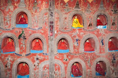 The Temple wall contains hundreds of Buddha statue's in alcove's the wall in Pagoda of Nyan Shwe Kgua temple near Inle lake,Shan state in Myanmar. Stock fotó
