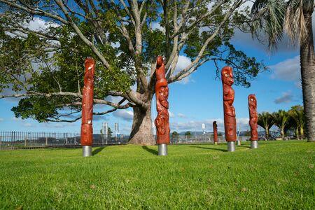 Maori totem poles or pou whenua on The Strand Tauranga, New Zealand Stock Photo