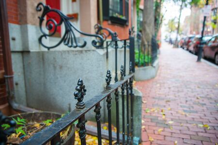 Selective focus on foreground with blurred background in street scene in plush residential suburb in Boston New England