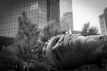 """St Louis USA September 2 2015; """"Eros Bendato� by Igor Mitoraj's bronze  sculpture of massive head into which your can climb and look out in St Louis, Missouri, USA City Garden Park."""